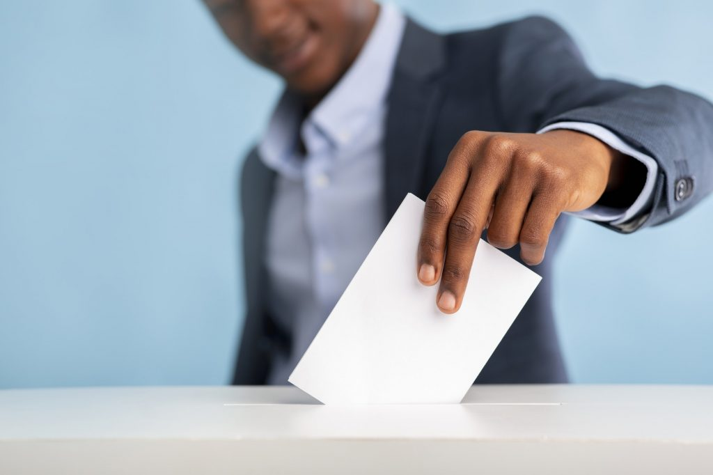 African man voted on president elections, blurred background
